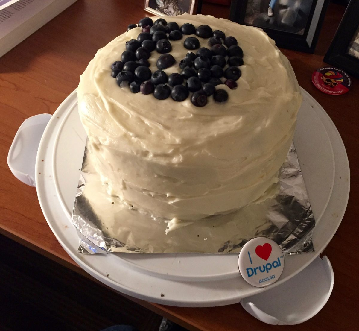 Cake with Drupal logo in blueberries