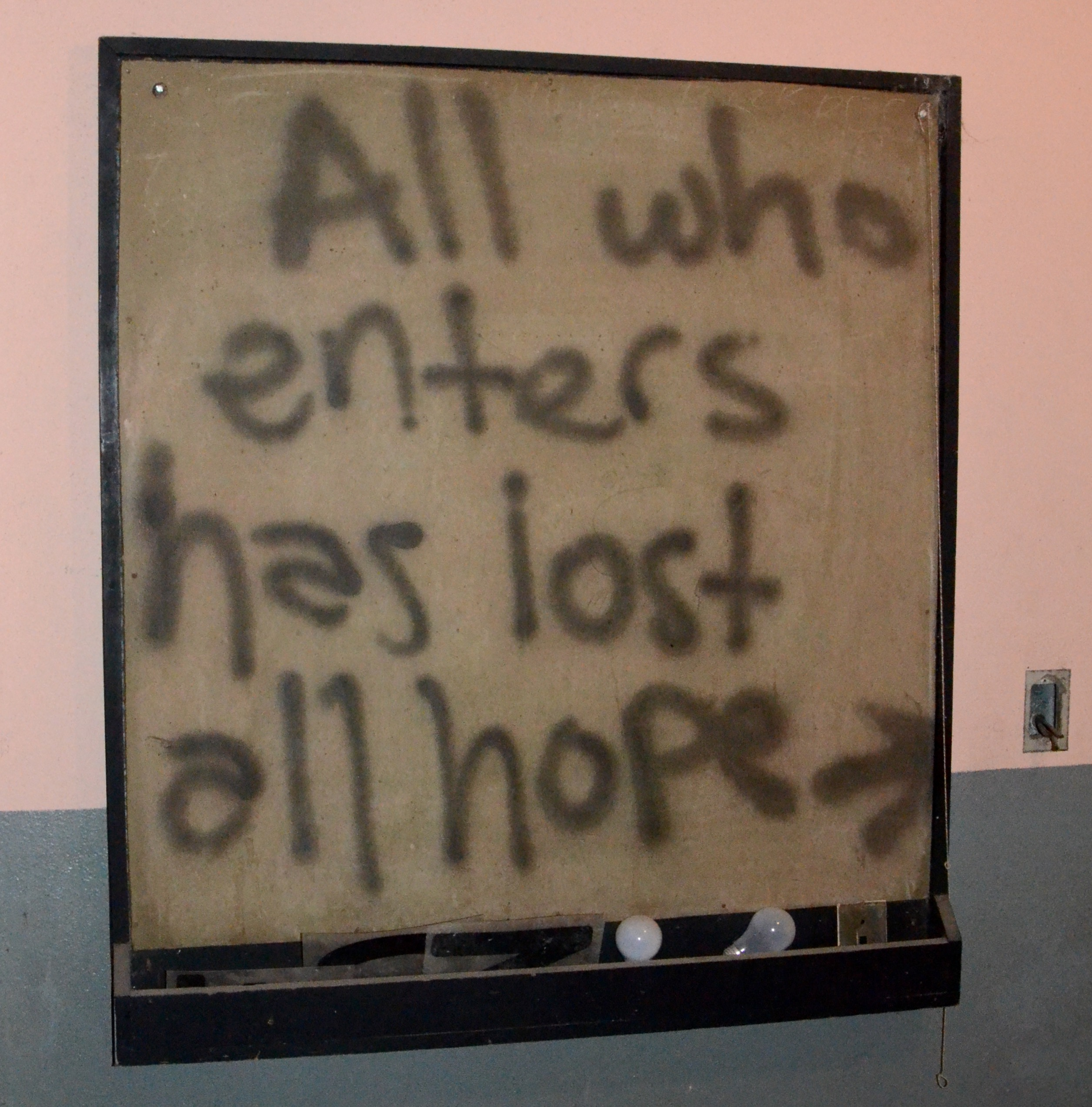 graffiti: All who enters has lost all hope.