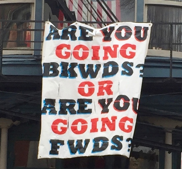 Handmade sign reading Are you going bkwds? or are you going fwds?