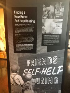 Self-Help housing signs from AFSC's 100's anniversary exhibit.