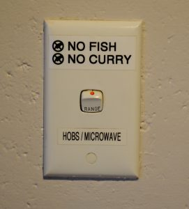Switch for a microwave labeled No fish, no curry.