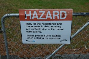 Sign warning about instability after an earthquake.