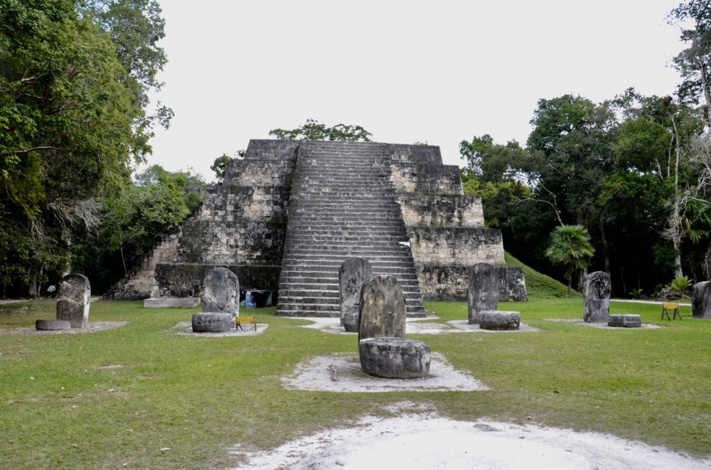 Stone Mayan temple with flat top.