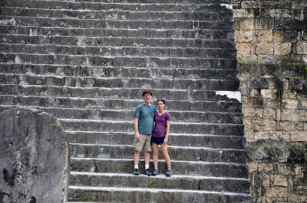 Two people standing on the stone stairs.