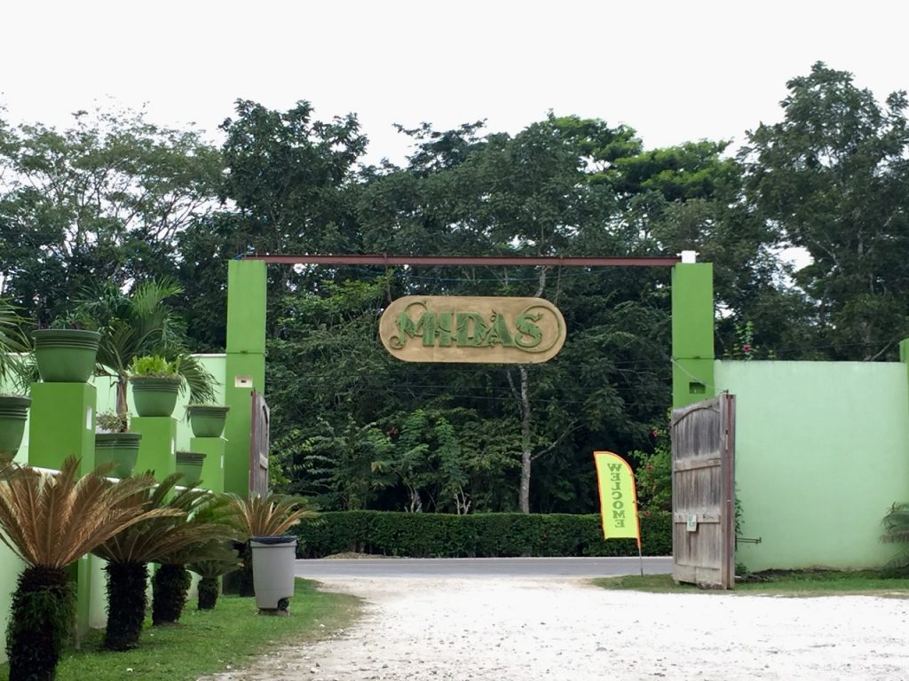 Sign over the entrance to a parking lot reads Midas.