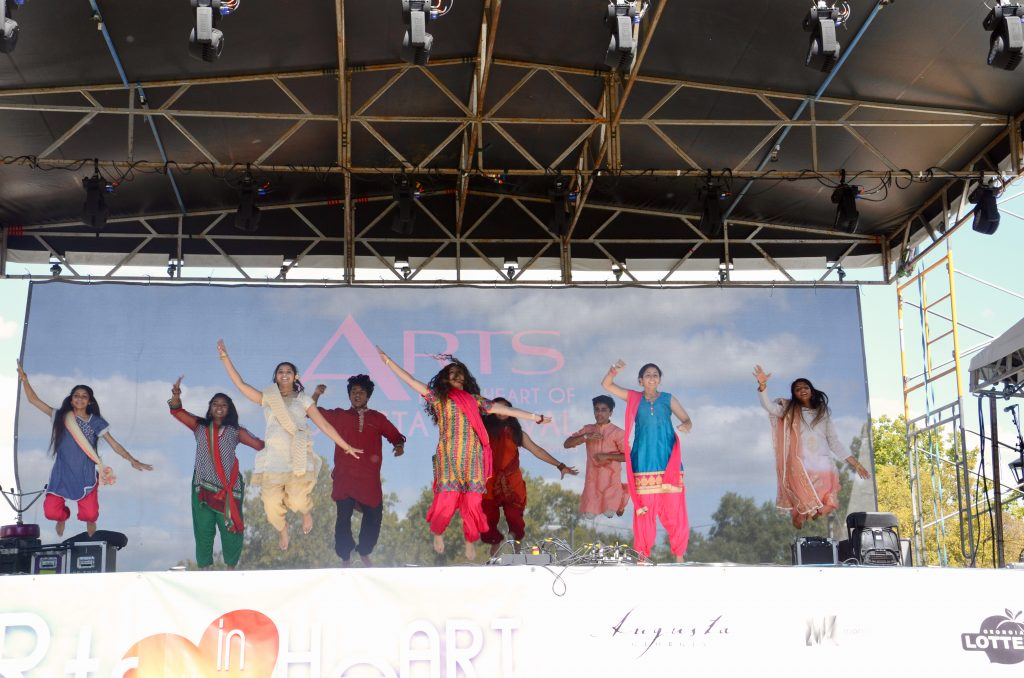 A group of teenagers from the Hindu temple society jump in unison during their performance.