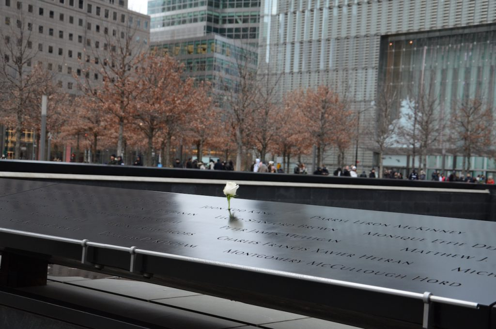 A single white rose in a name to mark the birthday of someone who died in the twin towers.